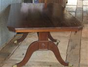 Sale 7379B - Lot 51 - A Regency style mahogany table with brass castors 1950 long x 950 w x 750 h.