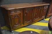 Sale 8291 - Lot 1070 - French Style Oak Sideboard, with four carved panel doors and two short drawers (key in office)