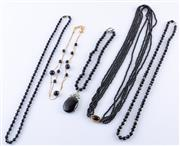 Sale 8550F - Lot 246 - Five various black beaded necklaces including jet.