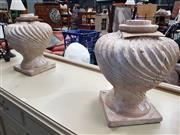 Sale 8744 - Lot 1078 - Pair of Cast Urns with Swirling Pattern