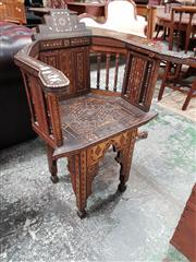 Sale 8792 - Lot 1042 - A Islamic Marquetry Armchair with geometric inlays having mother of pearl highlights on arcaded legs