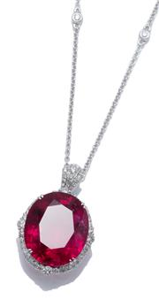 Sale 9029 - Lot 391 - AN 18CT WHITE GOLD RUBELLITE AND DIAMOND PENDANT NECKLACE; featuring an oval cut rubellite of approx. 15.82ct to surround and bale s...