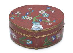 Sale 9123J - Lot 314 - A small cloisonne box of oval form with floral decorations and marking to base, width 6.5cm