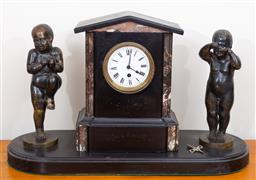 Sale 9103M - Lot 730 - A three piece clock garniture (marriage), a marble and slate clock with roman numeral dial, sitting no a timber plinth and flanked b...