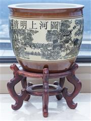 Sale 8593A - Lot 75 - An oriental jardiniere on stand depicting town scape, on stand
