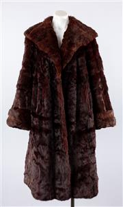 Sale 8760F - Lot 118 - A 3/4 length Astrakhan fur coat with wide, shawled lapel, approx size 12