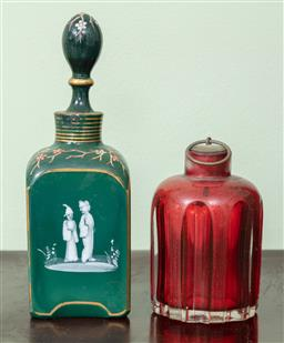 Sale 9120H - Lot 318 - A faceted red glass bottle and stopper together with a green enamelled example, Height of taller 18cm.