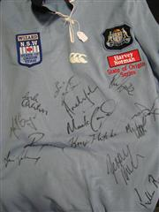 Sale 8125 - Lot 3 - NSW Origin jersey signed by 15 players including Andrew Johns, Matt Geyer, Mark Carroll et al