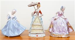 Sale 9103M - Lot 732 - Three ceramic lady figures, one marked and signed for Italy, and another with parasol and crinoline decorations, Height of largest 32cm
