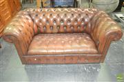 Sale 8260 - Lot 1096 - Brown Leather Two Seater Chesterfield Lounge