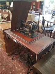 Sale 8740 - Lot 1148 - Sewing Table on Treadle Base