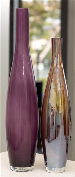 Sale 9162H - Lot 9 - Two graduating glass vases in purple and amber, taller Height 49cm