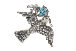 Sale 9194 - Lot 389 - A VICTORIAN STYLE SILVER STONE SET LOVE PENDANT BROOCH; lovebird carrying a sprig of Forget-Me-Not, all set with marcasites, seed pe...