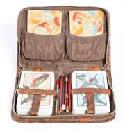 Sale 8575J - Lot 129 - A patinated leather travelling card case by Personality, concealing two decks of cards, scoring tablets and pencils, W 17cm