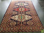 Sale 8485 - Lot 1033 - Turkish Wool Carpet, with three octagons, in red/green/ cream tones (304 x 195cm)