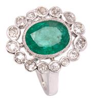 Sale 8991 - Lot 391 - AN EMERALD AND DIAMOND CLUSTER RING; set in platinum with an oval cut emerald of approx. 2.53ct to surround of collet set Old Europe...