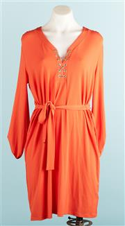 Sale 9071F - Lot 12 - A MICHAEL KORS LONG SLEEVE DRESS; in bright tangerine with gold chain detail to collar, size L