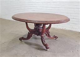 Sale 9126 - Lot 1034 - Good Victorian Burr Walnut Loo Table, the oval top on bird-cage base, with carved outswept legs (h:67 w:148 d:112cm)