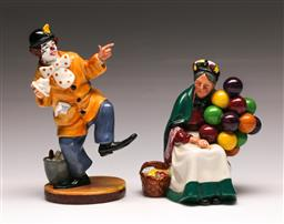 Sale 9136 - Lot 230 - A Royal Doulton old balloon seller (H 19cm) together with A Royal Doulton clown Figure (H 23cm)