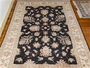 Sale 8270 - Lot 36 - An Afghan Chobi carpet, with black ground with floral motif, 261 x 172cm