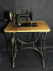 Sale 8600A - Lot 28 - Vintage Wertheim Francfort hand crank sewing machine with cast iron base on wheels, H 96cm.