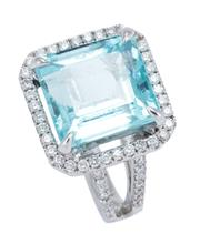 Sale 8928 - Lot 358 - AN 18CT WHITE GOLD AQUAMARINE AND DIAMOND RING; claw set with a square step cut aquamarine of approx. 6.6ct to surround, gallery and...