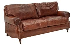 Sale 9245T - Lot 32 - A hand aged top grain vintage leather three seat sofa with large rolled arms, brass stud detailing, and two front castor legs. Dimen...