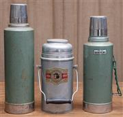 Sale 8984H - Lot 80 - A pair of Aladdin Stanley Thermos flasks together with an HK made example. Height of tallest 42cm