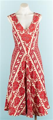 Sale 9071F - Lot 1 - A TRACY REESE V NECK DRESS; in red and cream silk floral patterns, cap sleeves and a pleated skirt, size S