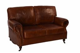 Sale 9245T - Lot 33 - A hand aged top grain vintage leather two seat sofa with large rolled arms, brass stud detailing, and two front castor legs. Dimensi...