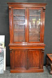 Sale 7972A - Lot 1017 - A Victorian Mahogany Veneer Bookcase with glazes doors above a cupboard base