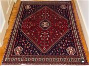 Sale 8270 - Lot 42 - A Persian Abada rug, with red ground and rhomboid motif, 152 x 105cm