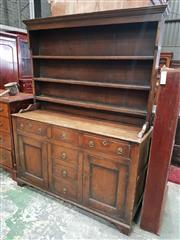 Sale 8956 - Lot 1019 - Probably Late Georgian Pine Dresser, the open shelves, above an arrangement of six drawers with later brass handles, flanking two pa...