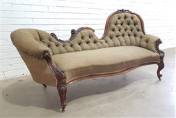 Sale 9126 - Lot 1117 - Victorian Carved Walnut Chaise Longue, with shaped back and raised end upholstered in a buttoned blue-green shot silk (?), raised on...