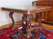 Sale 8270 - Lot 45 - An antique French fruitwood table. The top of serpentine outline on 4 carved scroll legs joined by shaped stretchers and a centre su...