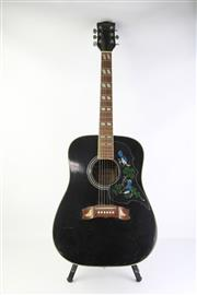 Sale 8783 - Lot 30 - Conora Acoustic Guitar