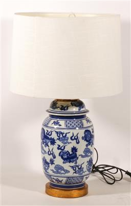 Sale 9110 - Lot 33 - A blue and white ceramic table lamp with cream shade (H:62cm)