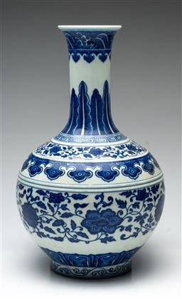 Sale 9211 - Lot 42 - A Chinese Blue and White Vase Featuring Flowers (H:40.5cm)