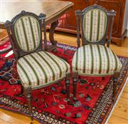 Sale 8270 - Lot 46 - A pair of antique English walnut carved chairs. The shaped back and shaped seats upholstered in Regency stripe. C: 1880