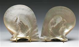 Sale 9144 - Lot 154 - A pair of mother of pearl panels on stand H18cm
