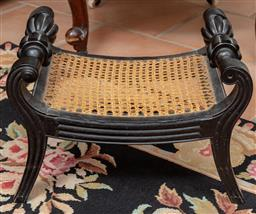 Sale 9120H - Lot 327 - An ebonised oak foot rest with cane top and fluted bow handles. Height 28cm.