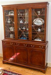 Sale 8270 - Lot 49 - An English Vintage two part Georgian design sycamore bookcase. The upper section fitted with adjustable shelving enclosed by three q...