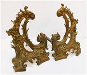 Sale 8362A - Lot 10 - A pair of late 19th Century French bronze and iron fire dogs, size of brass ware 45  x 30 cm