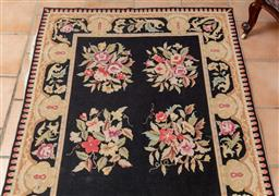 Sale 9120H - Lot 328 - A Floral tapestry with repeating bouquets against a black gound. 178cm x 120cm