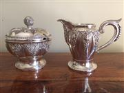 Sale 8259A - Lot 10 - A 19th Century German 800 Standard Creamer and Sugar Bowl, c 1880, each with chased foliate panels