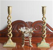 Sale 8470H - Lot 50 - A pair of brass candlesticks with helix stems, H 30cm,  together with a candle holder with a cherub base
