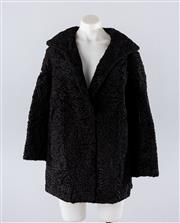 Sale 8760F - Lot 188 - A black Astrakhan fur coat, approx size 12
