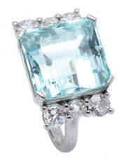 Sale 8991 - Lot 378 - A PLATINUM AQUAMARINE AND DIAMOND COCKTAIL RING; featuring a square emerald cut aquamarine of approx. 11.82ct to shoulders bead claw...