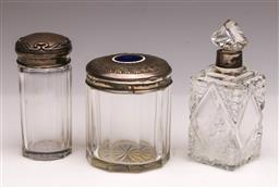 Sale 9110 - Lot 354 - Set of three hall marked sterling silver topped condiment bottles - some chips
