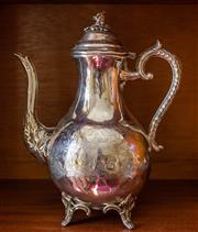 Sale 8270 - Lot 51 - A Victorian silverplate coffee pot raised on 4 scrolled bracket feet. C: 1890's, H 26cm
